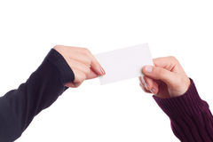 Two ladies hands holding a business card Royalty Free Stock Photos