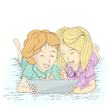 Two ladies happy with tablet Royalty Free Stock Photos
