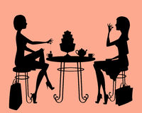Two ladies having a tea break after shopping Stock Image