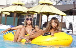 Two ladies lying on inflatable ring Royalty Free Stock Images