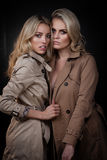 Two ladies in overcoats Royalty Free Stock Image