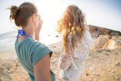 Two ladies on the sea coast Royalty Free Stock Photo