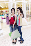 Two ladies shopaholic in the mall Stock Photography