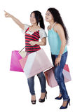 Two ladies with shopping bags Royalty Free Stock Image