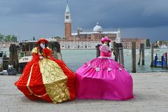 Two ladies in a traditional Venetian carnival dresses. Venice, Italy - 4 June 2016. Two ladies in a traditional Venetian carnival dresses and masks Royalty Free Stock Photos