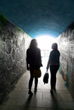 Two ladies in the tunnel, silhouette Stock Image