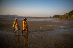 Two ladies walked home after fishery work Royalty Free Stock Image