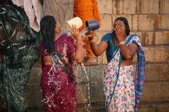 Two ladies washing in the  ganges river Royalty Free Stock Photography