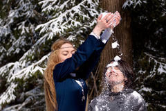 Two ladies in winter forest Royalty Free Stock Photo