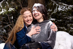 Two ladies in winter forest Royalty Free Stock Photography