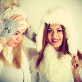 Two ladies in winter white outfit. Royalty Free Stock Images