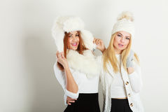Two ladies in winter white outfit. Royalty Free Stock Photo