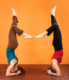 Two Ladies in Yoga Head Stands Royalty Free Stock Photography