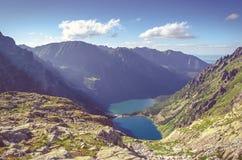 Two lakes in mountains. Stock Photos
