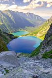 Two lakes in mountains. Stock Images