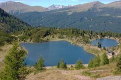 Two lakes near a mountain hut Royalty Free Stock Photos