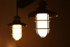 Two lamps. Two hanging lamps with metal cages stock photos