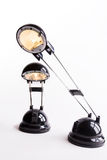 Two lamps. Two ignited black lamps on white bottom Royalty Free Stock Photos