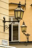 Stockholm, street fragment. Two lamps on the neighboring houses light streets in the evening, and in the afternoon have a rest and as though nod to the tourists royalty free stock image