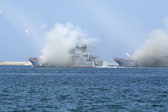 Two landing craft show missile firing in the Sevastopol Bay. The ships shoot at Sevastopol Bay during the Navy Day celebration royalty free stock image