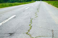 Two lane road crack. Two lane asphalt road crack Royalty Free Stock Images