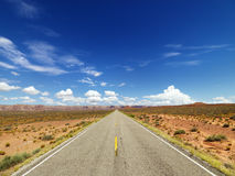 Two Lane Highway Through Desert royalty free stock images