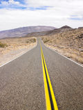 Two Lane Highway Through Desert Landscape Stock Photo