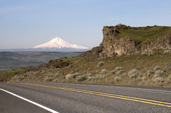 Two Lane Highway Reveals Mt Hood Cascade Range Landscape. Mount Hood stands out on the Oregon side traveling along the Columbia River Stock Image