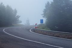 Two lane motorway covered in very thick fog. Two lane motorway in difficult weather conditions, covered in dense thick fog stock photography
