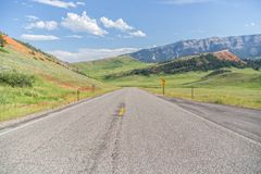 Two lane paved highway in the mountains Stock Photos