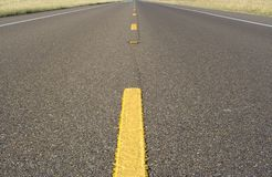 Two lane road. This is a photo of a two lane road Royalty Free Stock Photography