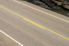 Two lane road in a diagonal view Stock Photography
