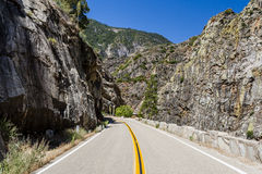 Two Lane Road Through Granite Rock King's Canyon California. Kings Canyon Scenic Byway, Highway 180, Kings Canyon National Park, Southern Sierra Nevada Stock Images