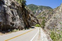 Two Lane Road Through Granite Rock King's Canyon California Stock Photography