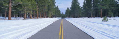 Two lane road in snow Stock Image
