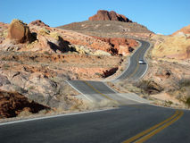 Two-lane road weaving through desert Royalty Free Stock Photo