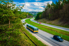 Two-lane wide road with cars. Stock Image