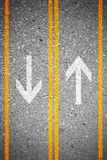 Two lanes asphalt concrete road texture as background. Asphalt concrete road texture as background. Two lanes and two directions sign on the road. Forward and Stock Images
