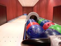Two lanes bowling alley. A private bowling alley with two lanes. Colorful bawls on the rack Royalty Free Stock Photography