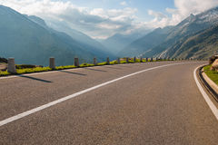 Two lanes of road, Grimsel pass, Alps, Switzerland Royalty Free Stock Photography