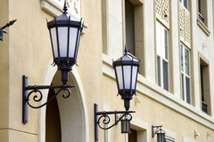 Two lantern on the wall of an apartment house Royalty Free Stock Photos