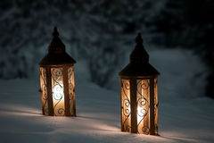 Two lanterns on snow Stock Photos