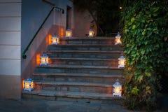 Two lanterns. Two white lanterns on the pavement Stock Photos