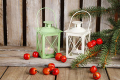 Two lanterns on wooden table Stock Images