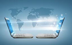 Two laptop computers with world map hologram. Technology, internet and connection concept - two laptop computers with world map hologram Stock Photography
