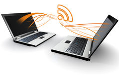 Two Laptops communicating RSS Royalty Free Stock Images