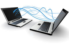 Two Laptops communicating wirelessly Royalty Free Stock Photo