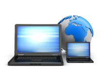 Two laptops and earth globe Stock Photos