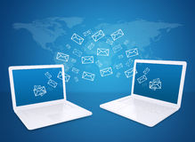 Two laptops exchange letters. The concept of e-mailing Stock Image
