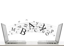 Two laptops and letters Stock Photos